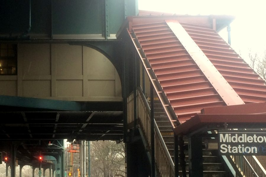 A stairway entrance to the elevated Middletown Road station of the New York City Subway system.