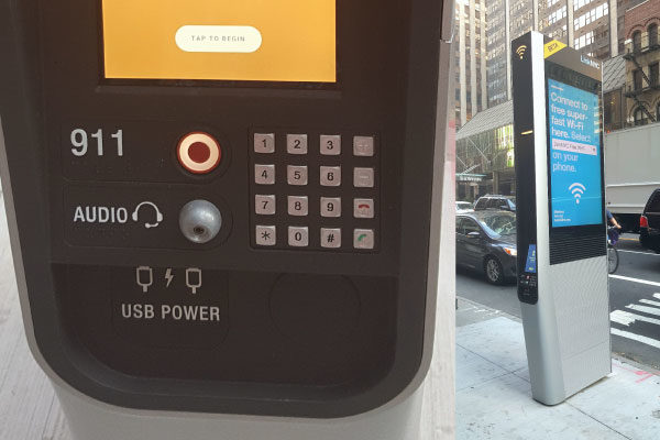 Composite of two photos. Left side: a panel of buttons on a Link station, including a touch screen saying 'Tap to Begin' and analog buttons for dialing phone numbers. There is also a red button for calling 911, an audio jack, and USB ports. Right side, the Link station is shown on a sidewalk, with a bright advertising screen on its side.