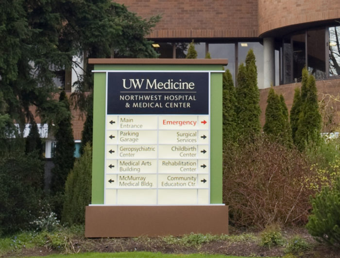 The monument sign for Northwest hospital, directing drivers towards its various departments such as Emergeny room, Surgical services, Medical Arts Building, etc.