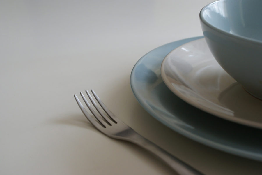 Fork with stacked plates and bowl.
