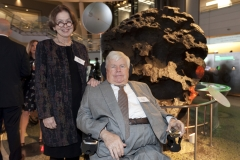 Evan Davis (DRA advisory board) and guest in front of an exhibit in the Cullman Hall of the Universe at the American Museum of Natural History, NYC