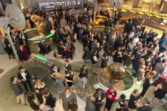 Overhead picture of many guests mingling during the cocktail hour in the Cullman Hall of the Universe at the American Museum of Natural History, NYC