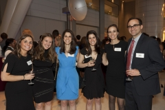 Shelly Feldman (DRA staff), Rebecca Klein (DRA staff), Seth Packrone (DRA staff), and guests smiling for the picture