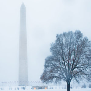 Washington DC in winter, a snowy landscape with the Washington Monument in the background