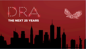 "An eagle made of light, soaring on a redbackground over the buildings of NYC. Text reads ""DRA: The Next 25 Years"""