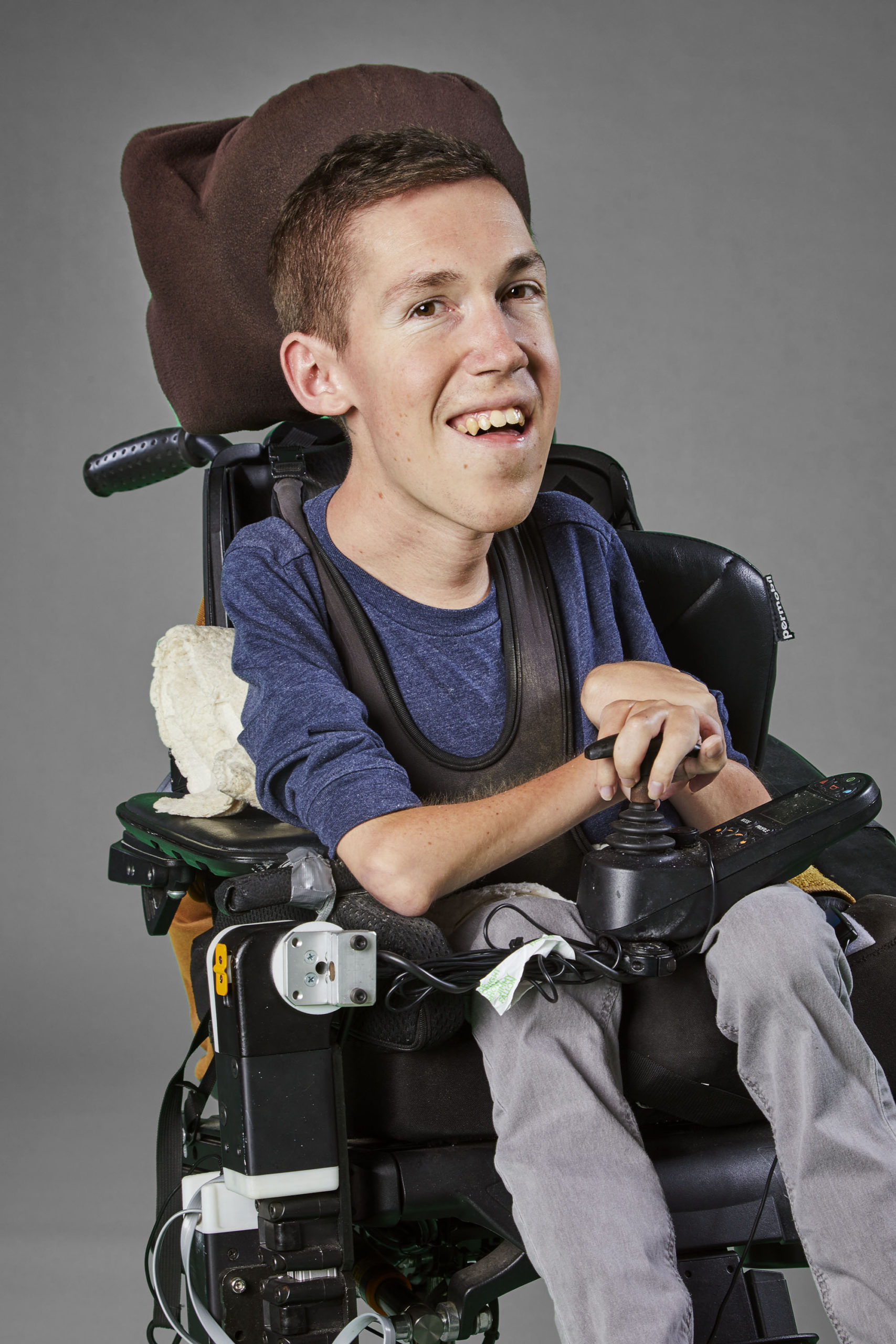 Shane Burcaw sitting in his wheelchair and smiling