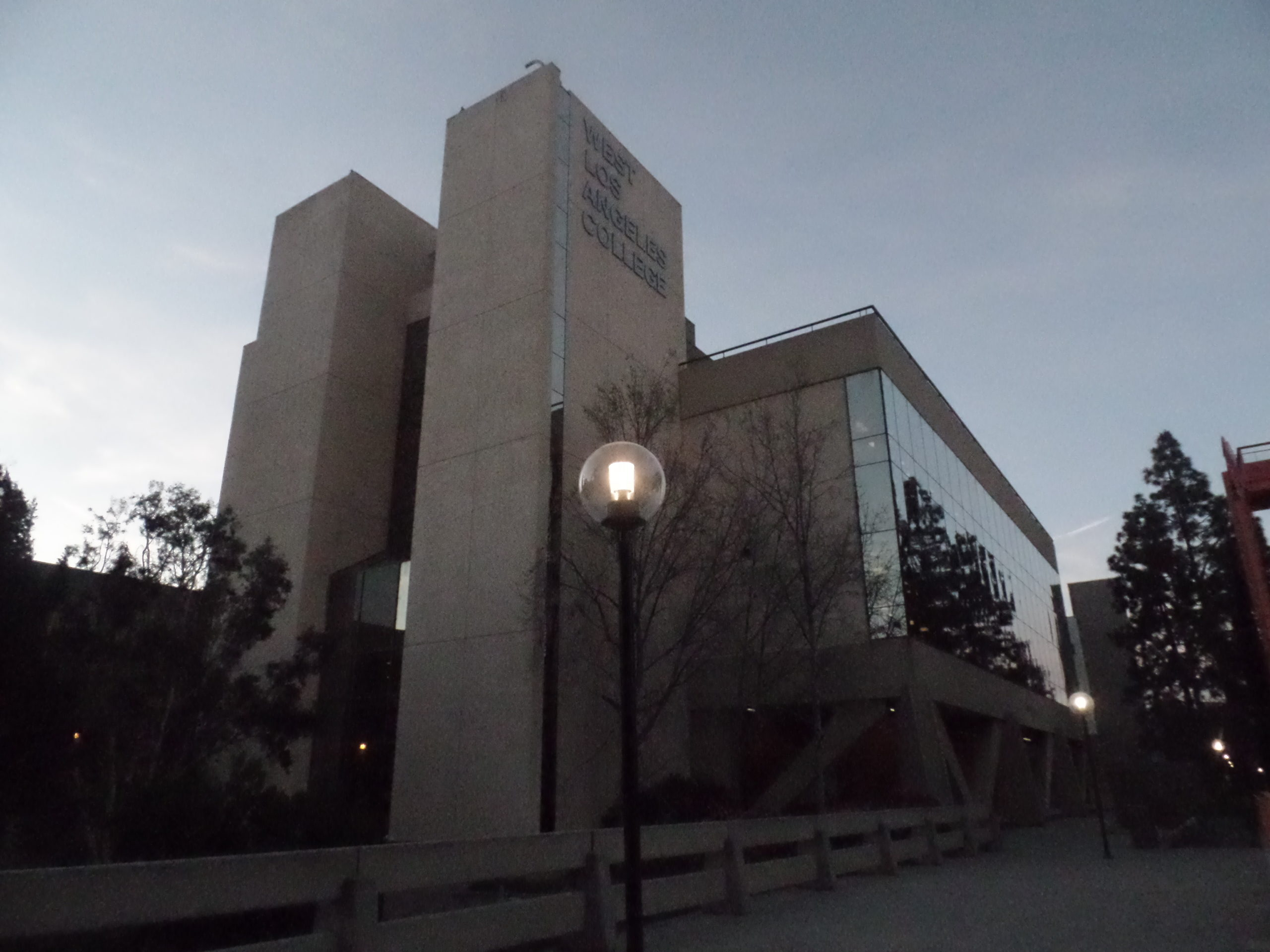 "An outside view of a building at WLAC, with text on the building ""West Los Angeles College"""