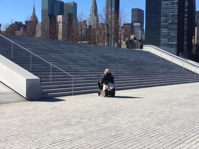 Edith Prentiss in a wheelchair at the bottom of a staircase preventing access to FDR Four Freedoms Park, NYC