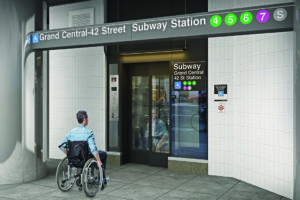 Man in wheelchair waiting for elevator outside Grand Central Subway Station in NYC