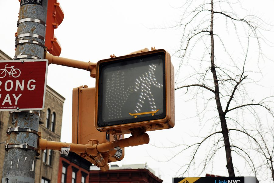 A pedestrian signal showing the white walking figure