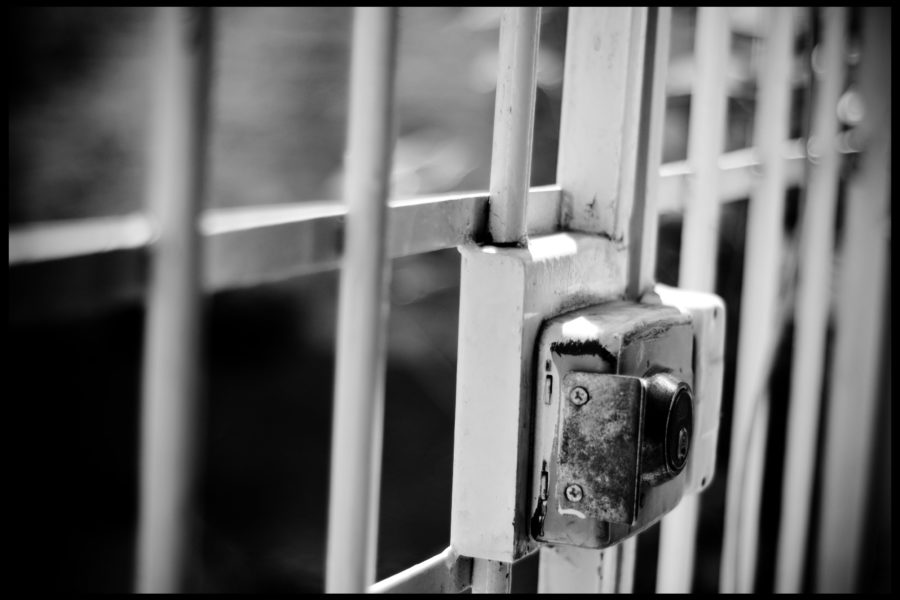 The bars of a jail cell.