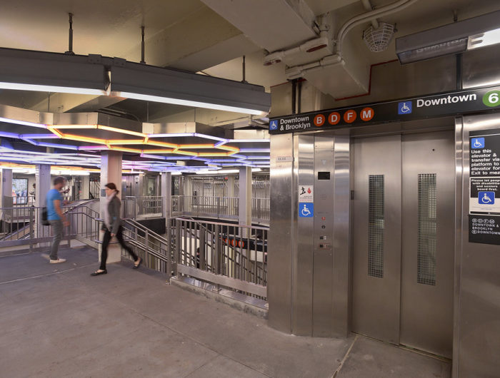 Elevator and staircase inside NYC subway station