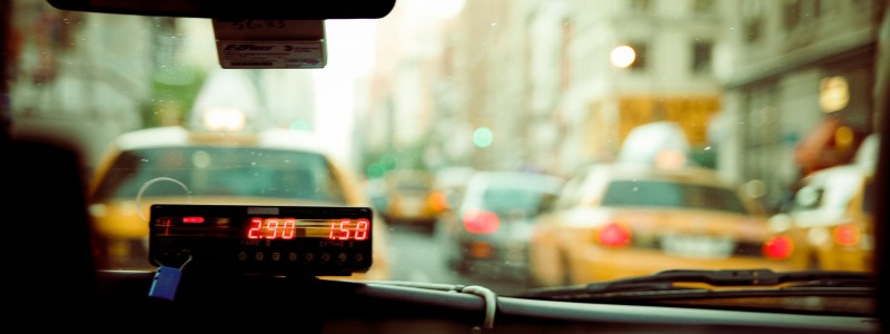 Image of a running meter from the inside of a taxi cab.