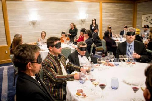 Guests enjoy a blindfolded wine tasting.