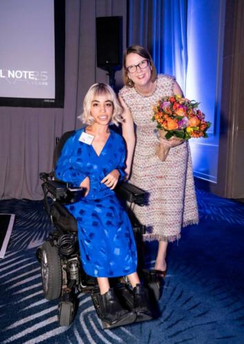 Eagle Awardee Jenny-Lay Flurrie and model Jillian Mercado, who uses a wheelchair, smile for the camera.