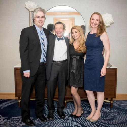 DRA Managing Directors Stuart Seaborn, Sid Wolinsky, Michelle Caiola, and Kate Hamilton smile for the camera.