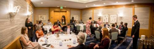 A panoramic view of the blindfolded wine tasting.